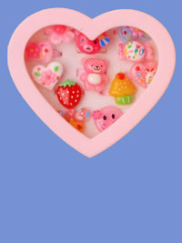Rings / Heart shaped box of 12 plastic kids character rings.