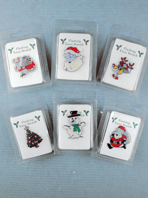 Xmas / Clip strip of 12 christmas flashing brooches.