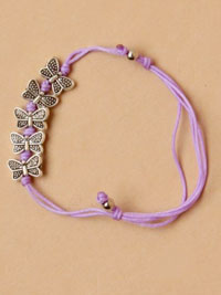 Bracelet / Coloured corded bracelet with Silv bfly charms.