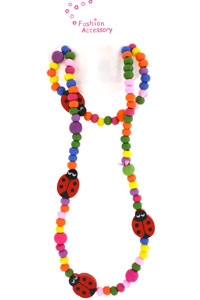 Neck / Blet. Bright coloured wooden bead and ladybird beads