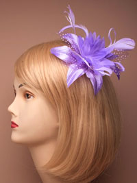 Fascinator / Molly - Coloured feather flower on a clip.