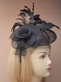 Fascinator / Heather - Large net and sinamay hatinator.