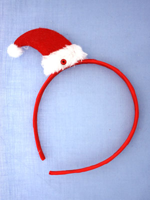 Clearance / Christmas red santa hat on aliceband.