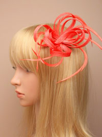 Fascinator / Oriel - Coral Looped sinamay and feather.