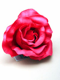 Clip / Large fuchsia pink fabric rose on a forked clip.