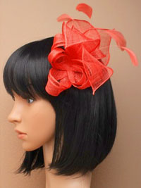 Fascinator / Beth - Coral sinamay fascinator on a comb.