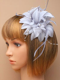 Fascinator / Jasmin - Silver layered flower with feathers.