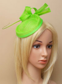 Hatinator / Holly - Green hatinator with ostrich quill.