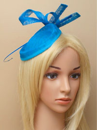 Hatinator / Holly - Teal hatinator with ostrich quill.