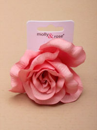 Clip / Large pastel coloured fabric rose on a forked clip.