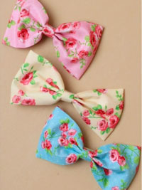 Barrette / Ditsy rose floral fabric bow on a clip.