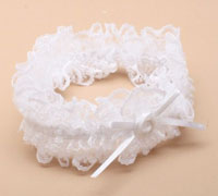 Garter / White lace garter with ribbon bow.