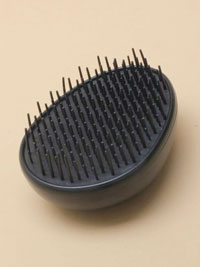 Hairbrush / Black detangling hair brush.