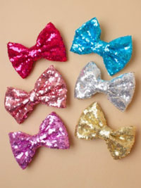 Clip / 12cm shiny sequin bow on a forked clip.