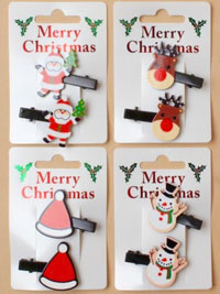 Xmas / 2pk Christmas character beak clips on a clip strip.