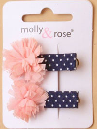Clips / Pair of fabric ruffle on navy spot beak clips.