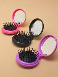 Hairbrush / Folding compact hair brush with mirror.