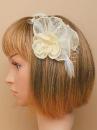 Fascinator / Dani -Cream sinamay flower and net fascinator