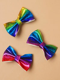 Clip / 8cm holographic rainbow bow on a clip.
