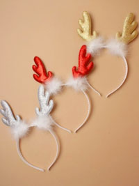 Xmas / Glitter Reindeer antlers on a white aliceband.