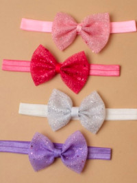 Bandeau / Children's elastic bandeau with sequin bow.